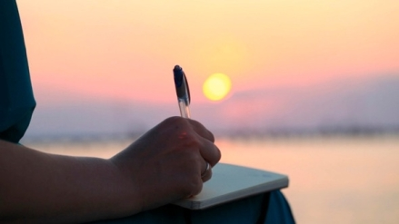Woman Writing In Her Diary At Sunset By Grey_Coast_Media | Videohive intended for Woman Writing In Diary